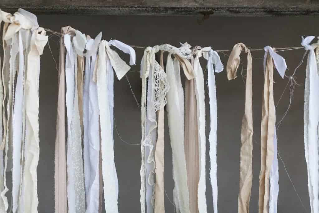 strips of cloth and lace tied to and hanging down from a string similar to a clothesline