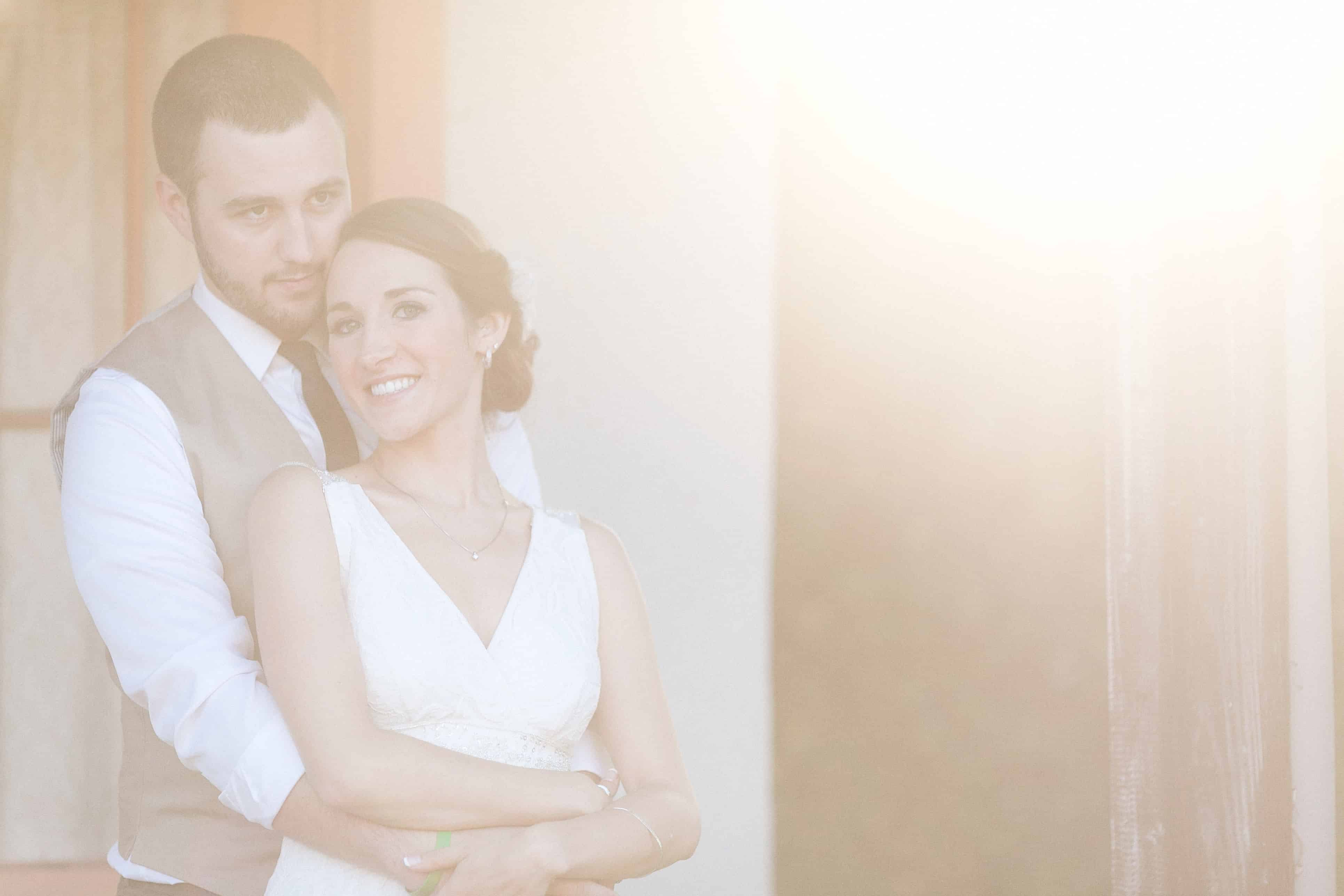 wedding photography sun flare | the johnsons plus dog