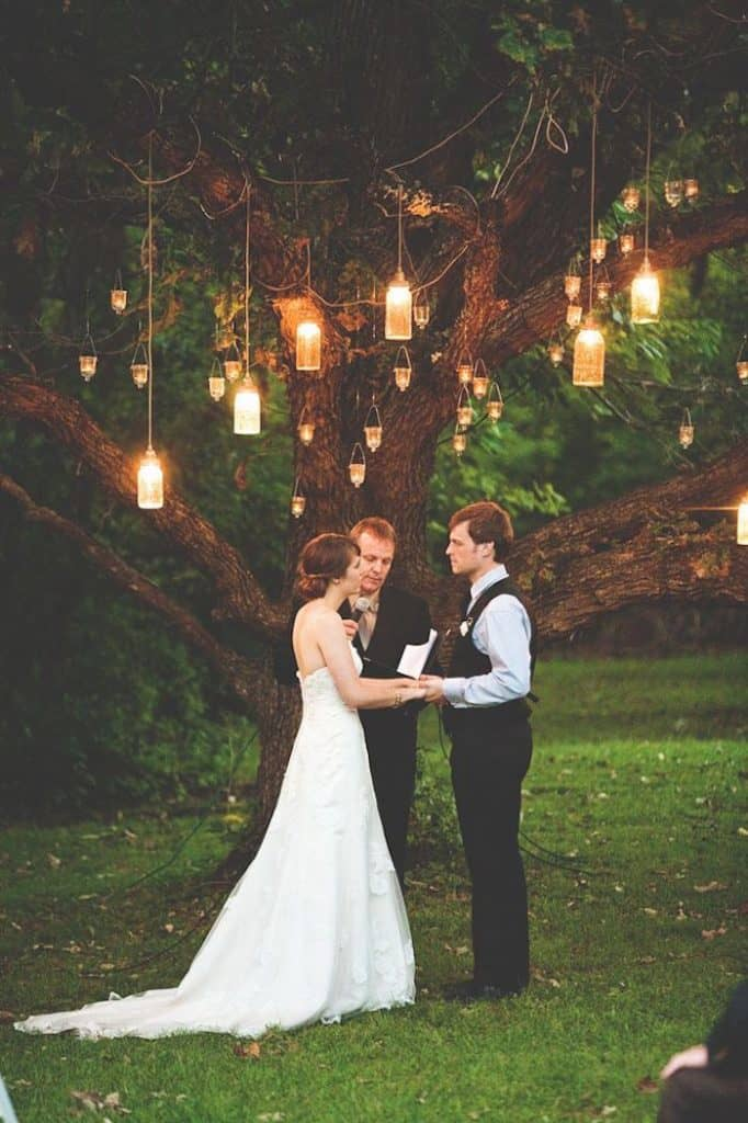 Creative Wedding Ceremony Decor Ideas | Hang mason jar candles from the trees for a romantic feel at your wedding ceremony