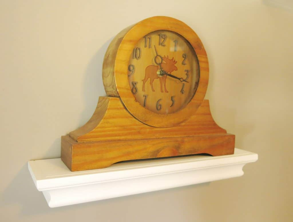 wooden clock with a moose design on the face