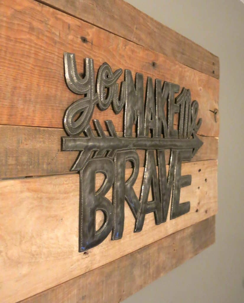 "close up photo of a metal sign that reads ""you make me brave"""