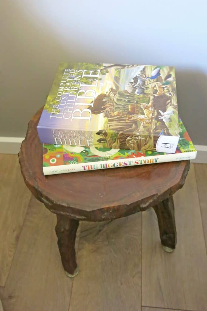 two children's books on a wooden stool
