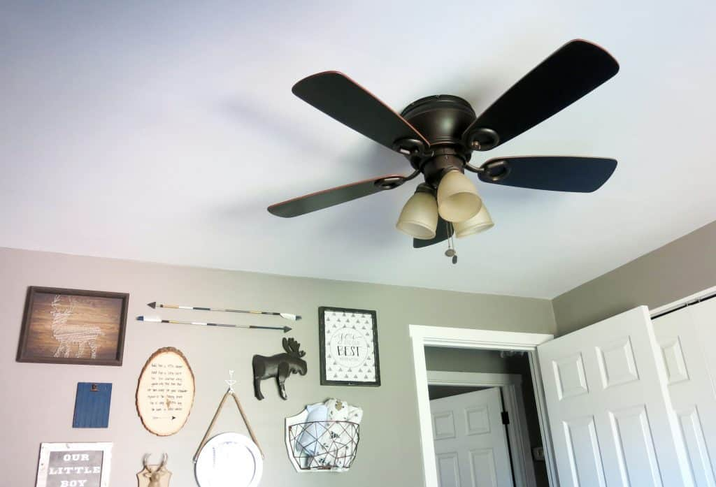 ceiling fan and gallery wall in a nursery