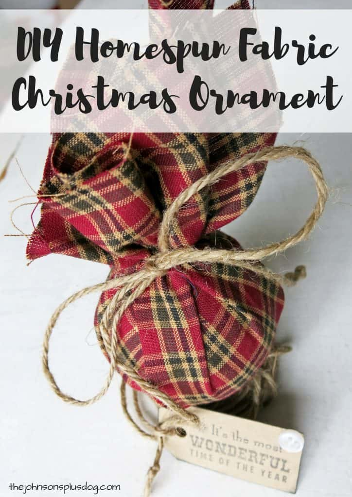a homemade christmas ornament wrapped in plaid fabric with twine tying off the top and a decorative tag ...with a text overlay that says... DIY homespun fabric christmas ornament