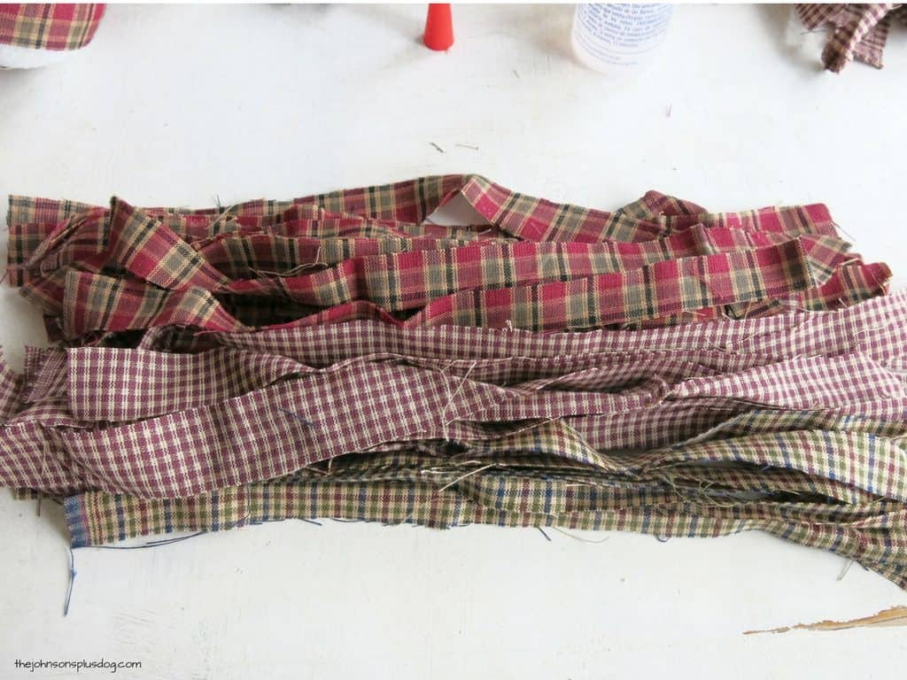 plaid fabric strips laid lengthwise on a white surface