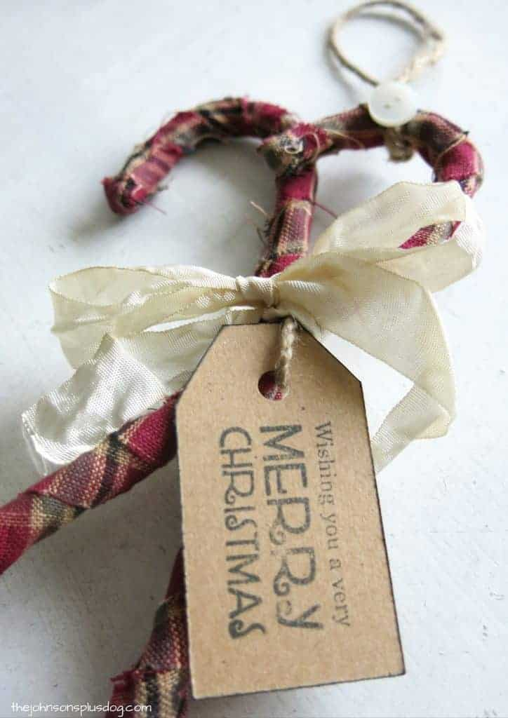 finished fabric wrapped candy cane ornament, with a decorative tag that says wishing you a very merry christmas