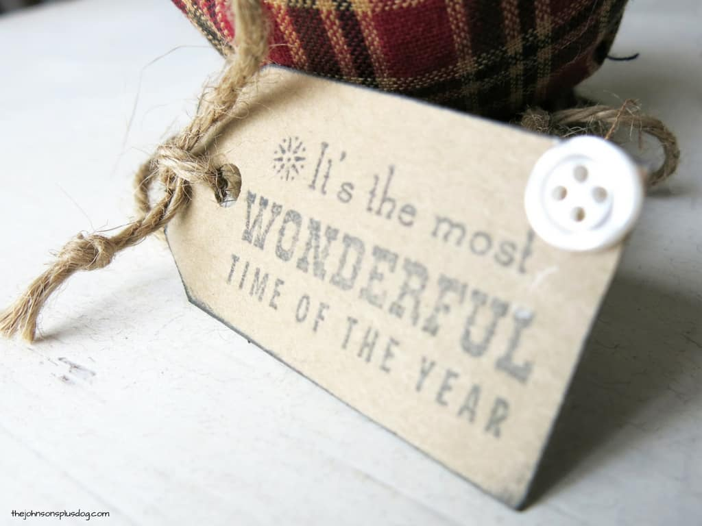 a close up of a decorative tag that says it's the most wonderful time of the year