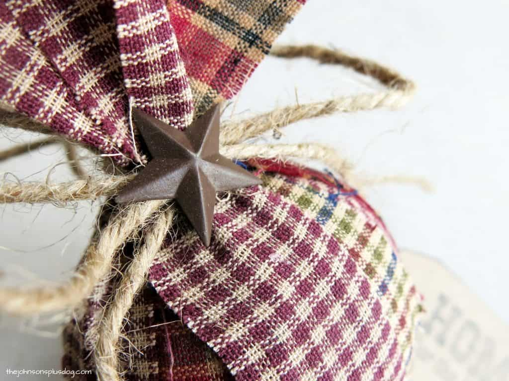 close up of the tied twine and small star decoration on the top of the ornament