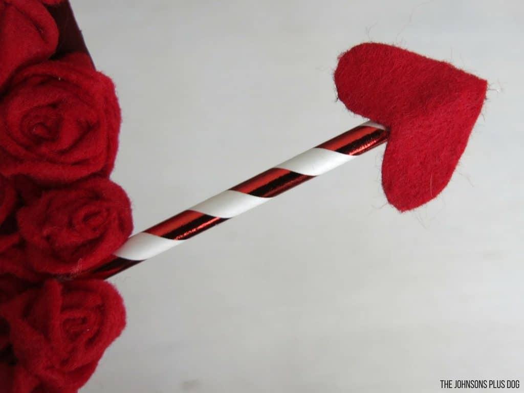 Felt Rosette Valentine's Day Wreath | DIY Valentine's Day Wreath tutorial | Heart wreath with arrow | Felt rosettes on a wreath | Red rosette | Valentine's Day decor | Vday wreath | How to make felt rosettes | Red flower wreath | Wreath using cardbard | Heart wreath | Wreaths using felt | How to make a heart wreath | February decorations | V-Day Decor
