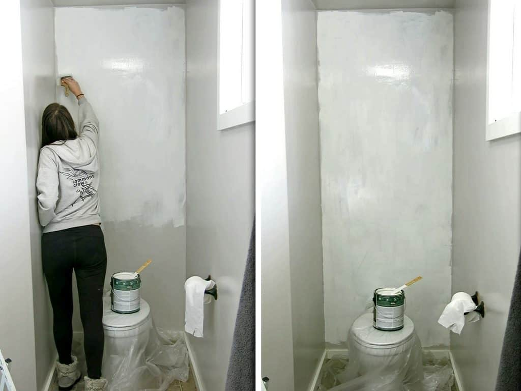 women painting wall behind toilet in preparation of installing shiplap