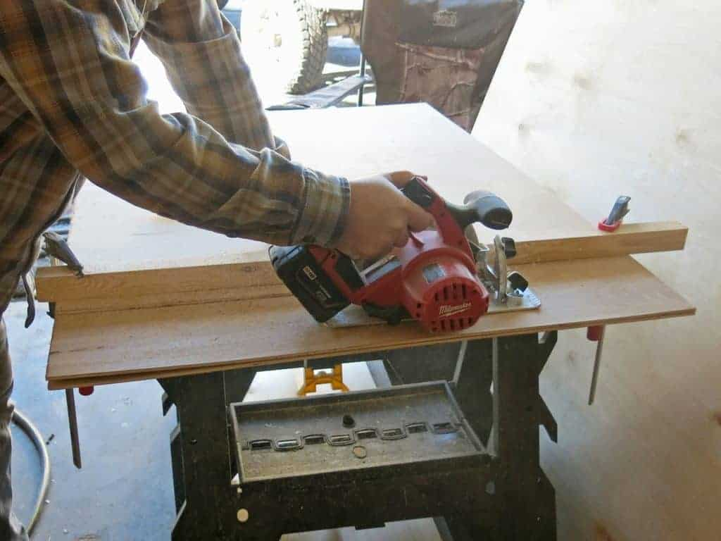 Man cutting plywood with skill saw and fence without a tablesaw