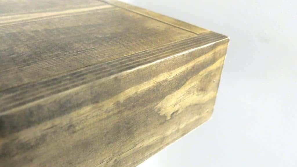 Photo of the corner of wood floating shelves