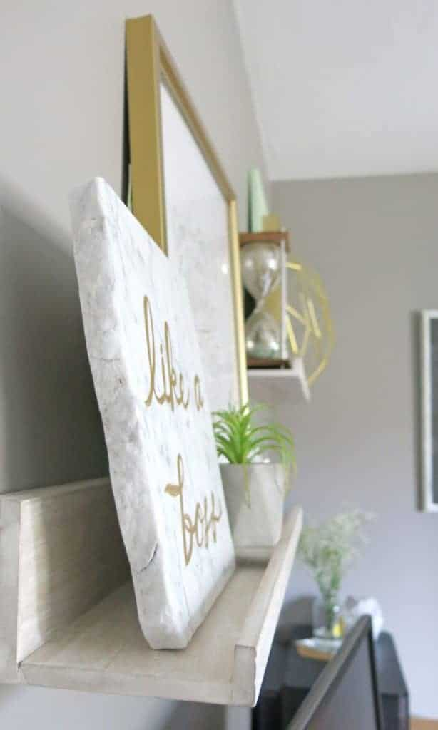 These floating art shelves are front Minted and are perfect for displaying art work in a home office space