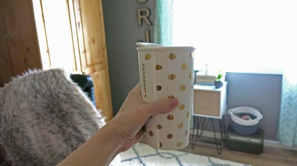 Holding a cute gold polka dots Starbucks mug