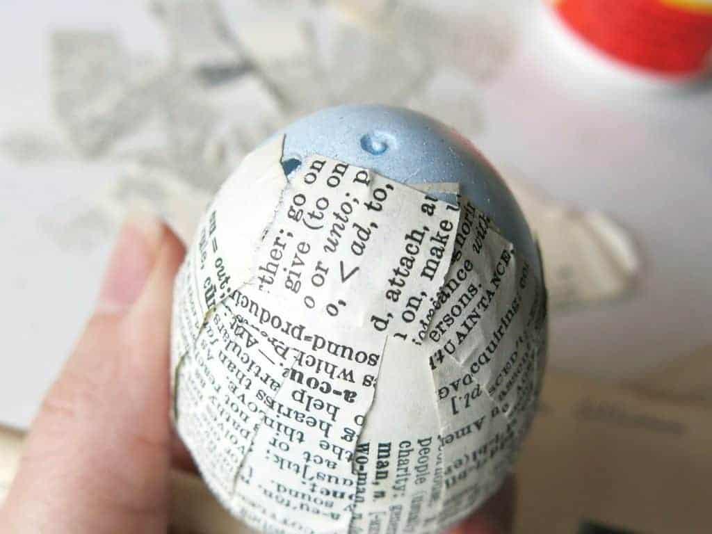 Using mod podge to upcycle plastic Easter eggs into stylish vintage decor.