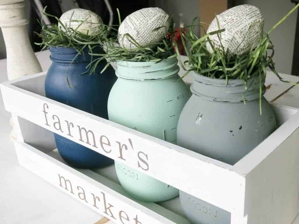 Create a fun Easter centerpiece with your upcycled easter egg, some mason jars, and grass.