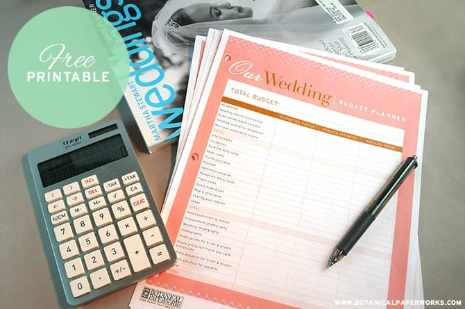 free wedding printable paper laying on table with pen, calculator and wedding magazine