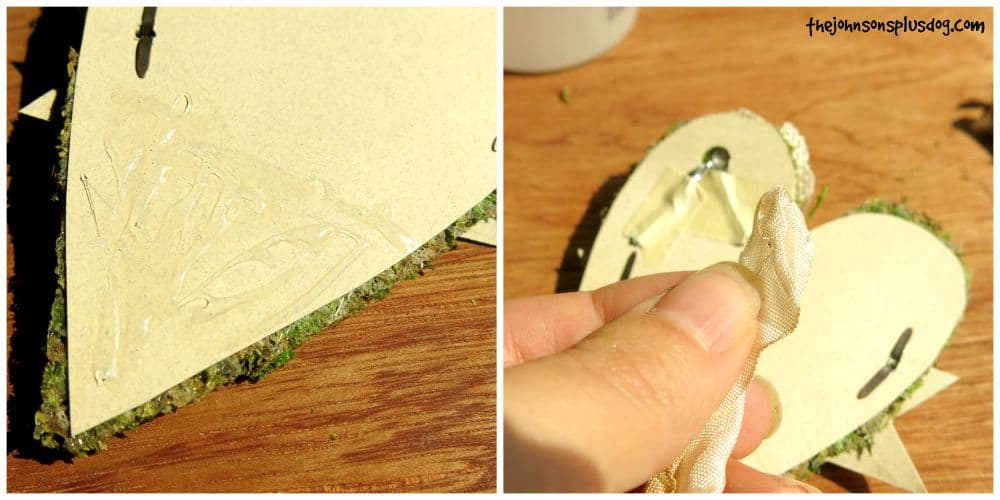 Using glue to attach ribbons to the back of the adorable rustic baby shower name tag