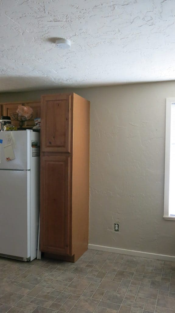 Blank spot open next to kitchen cabinets to be used for a DIY pantry