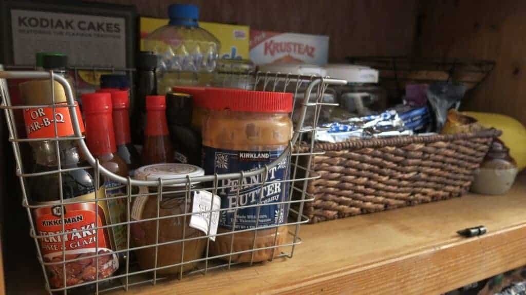 Wire baskets in DIY pantry to organize food