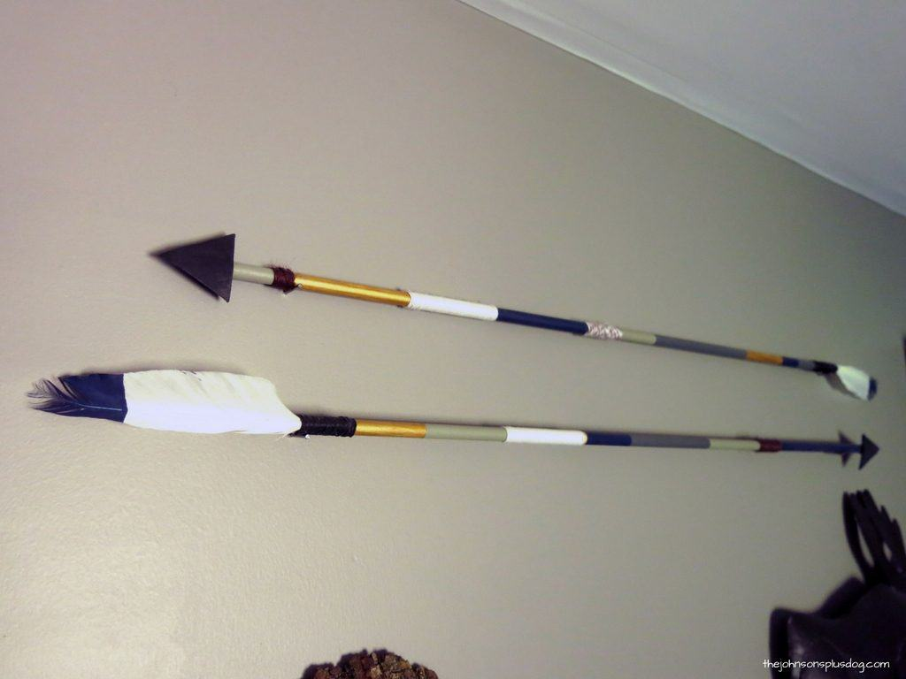Full close up view of two diy arrows hanging on the wall