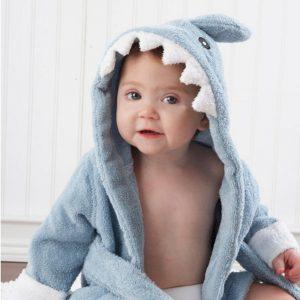 Baby wearing cute shark robe for bathtime