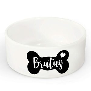 white dog bowl with brutus name written on it with a black bone