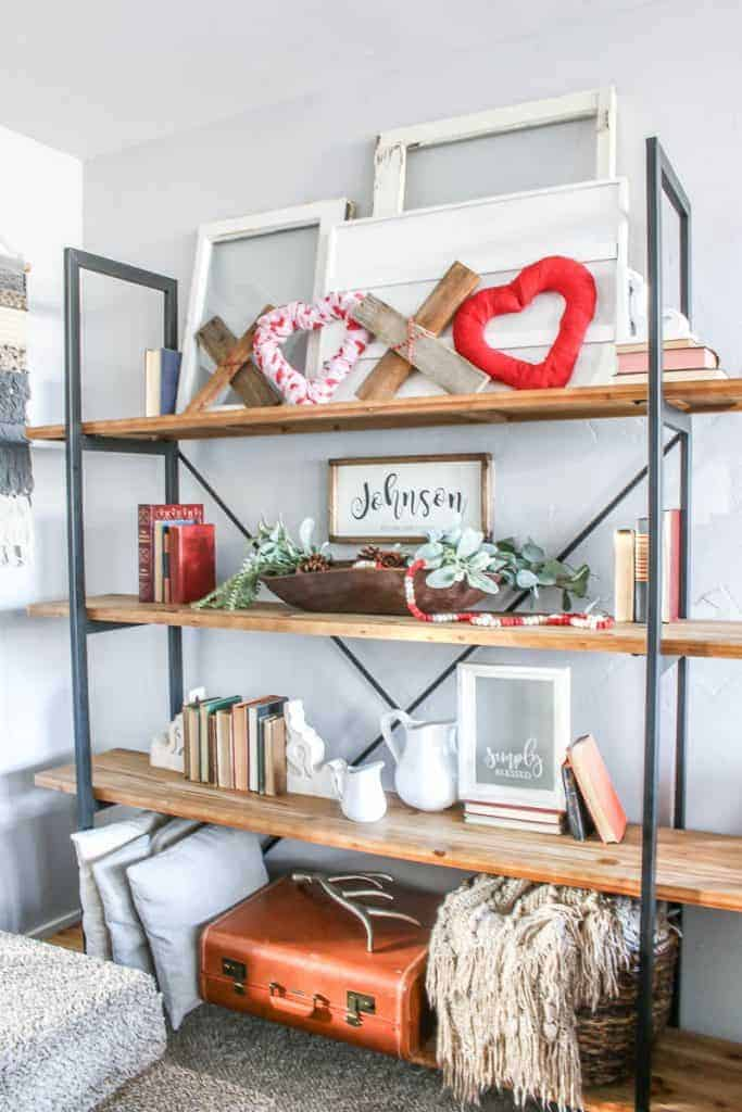 DIY XOXO Valentine's Day home decor on the living room shelves along with other farmhouse home decor