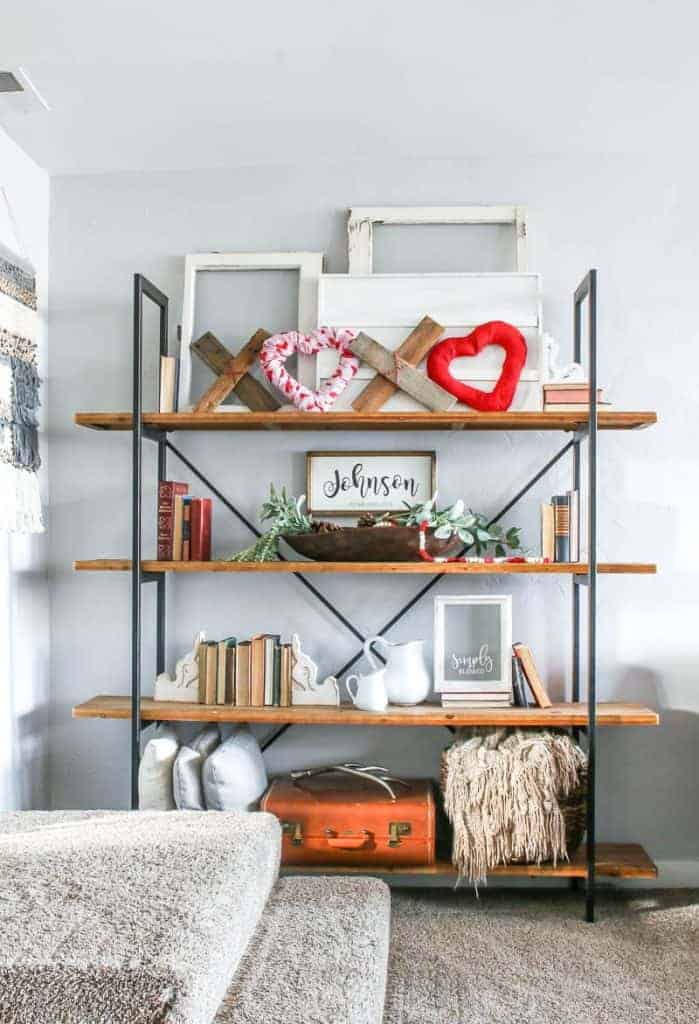 Full view of the living room farmhouse shelves with the DIY XOXO Valentine's Day home decor at the top most shelf along with other farmhouse home decor