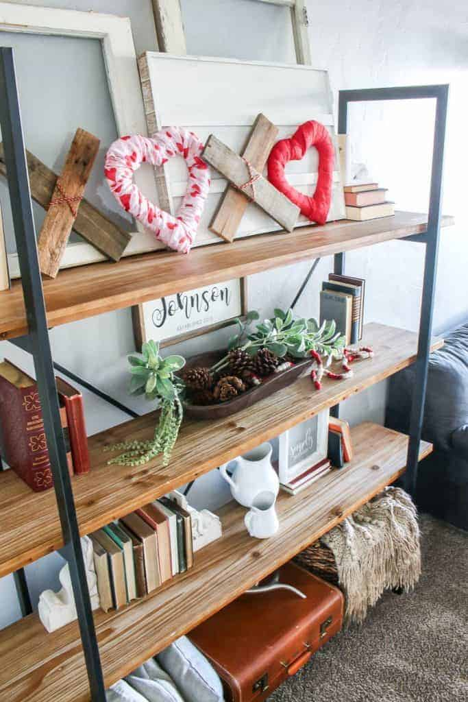 Living room shelves with DIY XOXO Valentine's Day home along with other farmhouse home decor