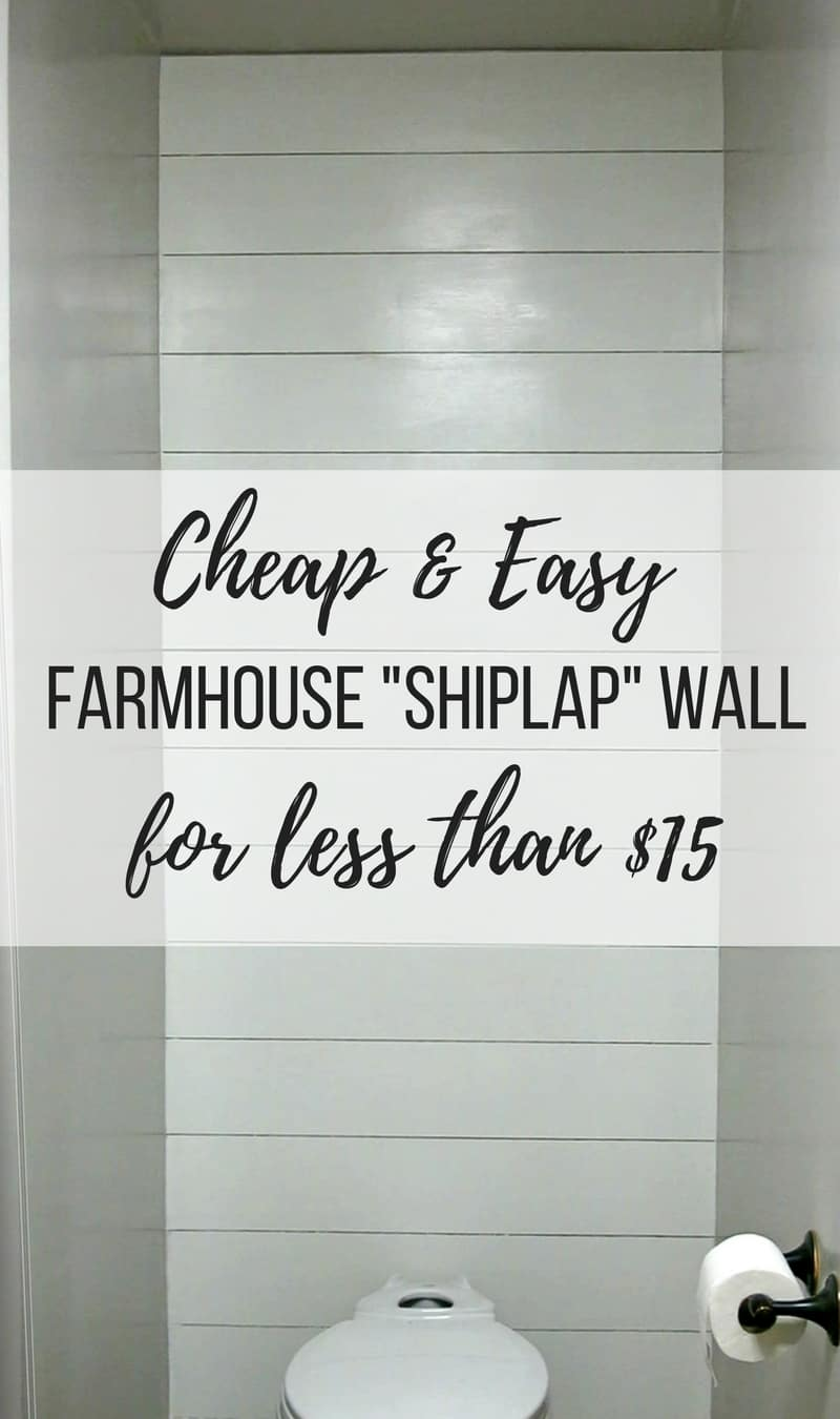 Shiplap wall installed on small wall behind toilet in bathroom with text overlay that says cheap and easy farmhouse shiplap wall for less than $15