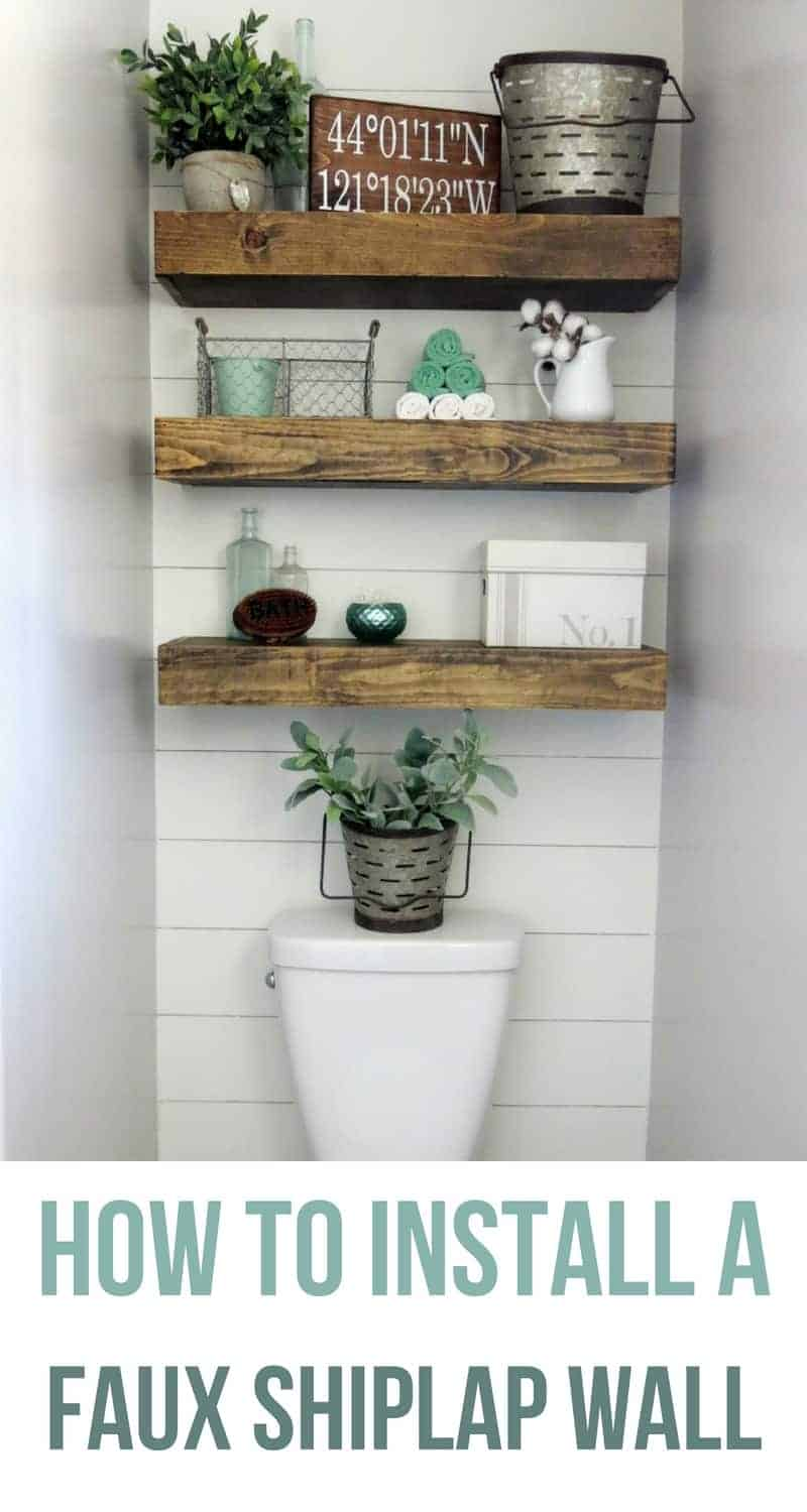 Faux shiplap wall behind toilet with wooden floating shelves decorated with farmhouse style with text overlay that says how to install a faux shiplap wall