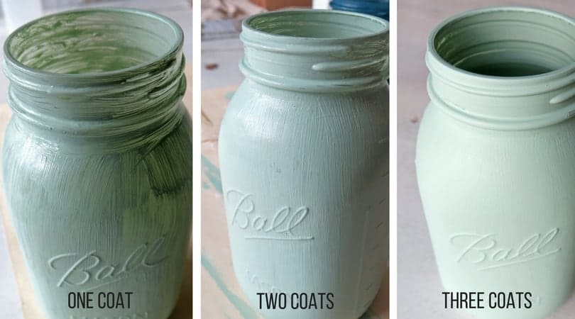 Three photos showing what a mason jar looks showing the progression of three coats of acrylic craft paint