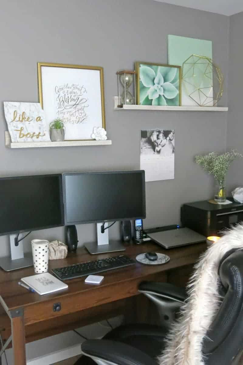 Desk with shelves on wall above a computer desk with gray walls painted with Fashion Gray by Behr