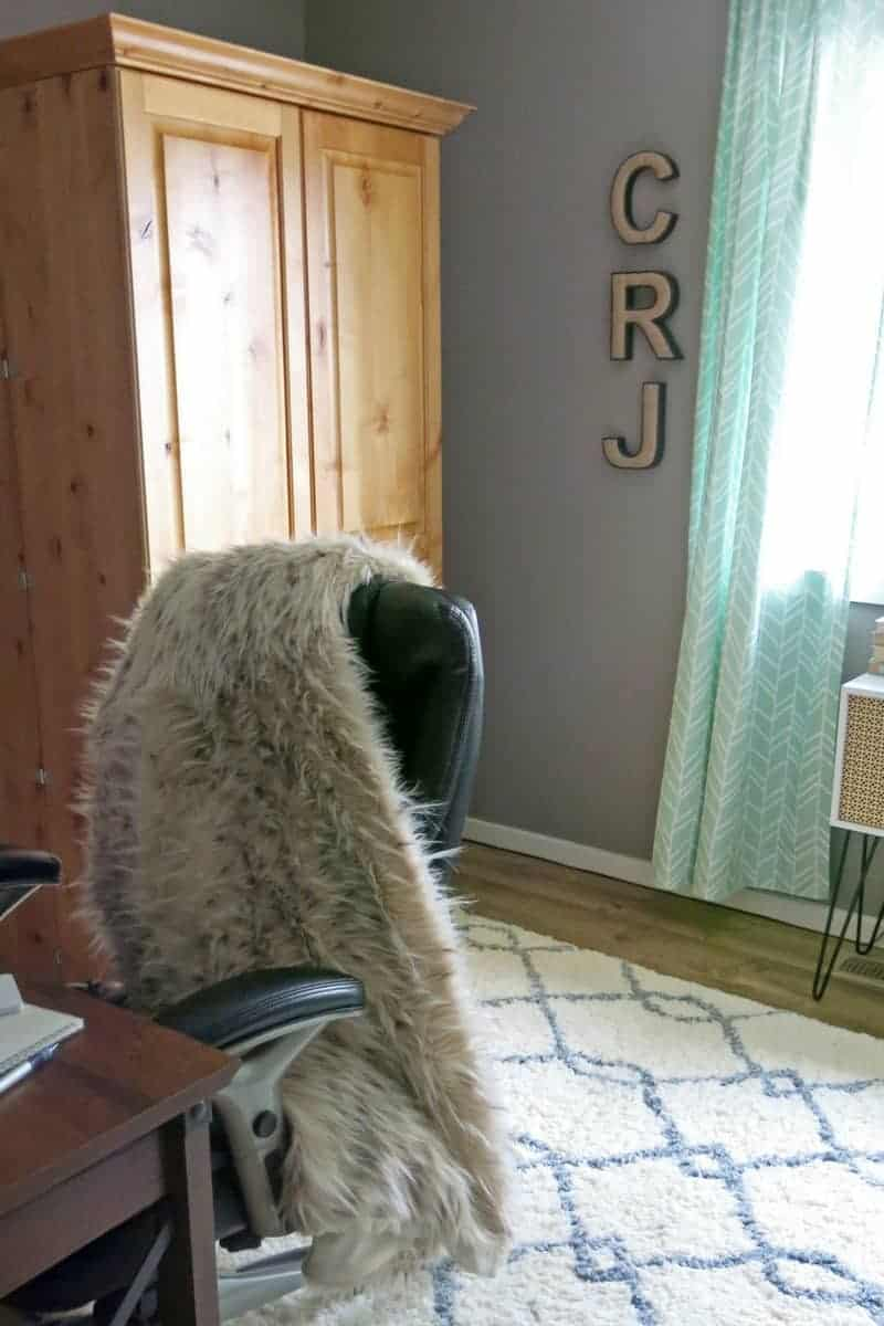 Fur Throw on the back of office chair, white and gray rug, shaggy rug, burlap memo board letters on the wall, arts and crafts large wooden cabinet for the Gold & Marble Home Office