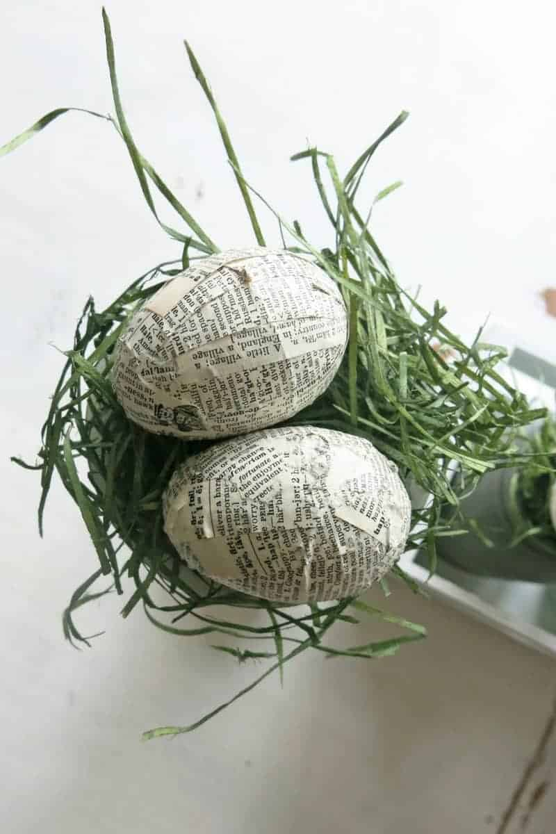 Upcycled plastic Easter eggs decorated with vintage book pages are part of an easy DIY Easter centerpiece
