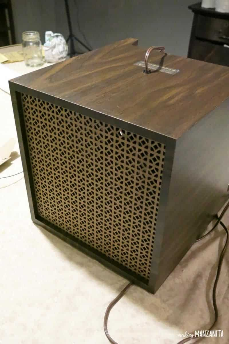 angled shot of a box with a decorative grille on the front to be turned into a box for how to hide wires
