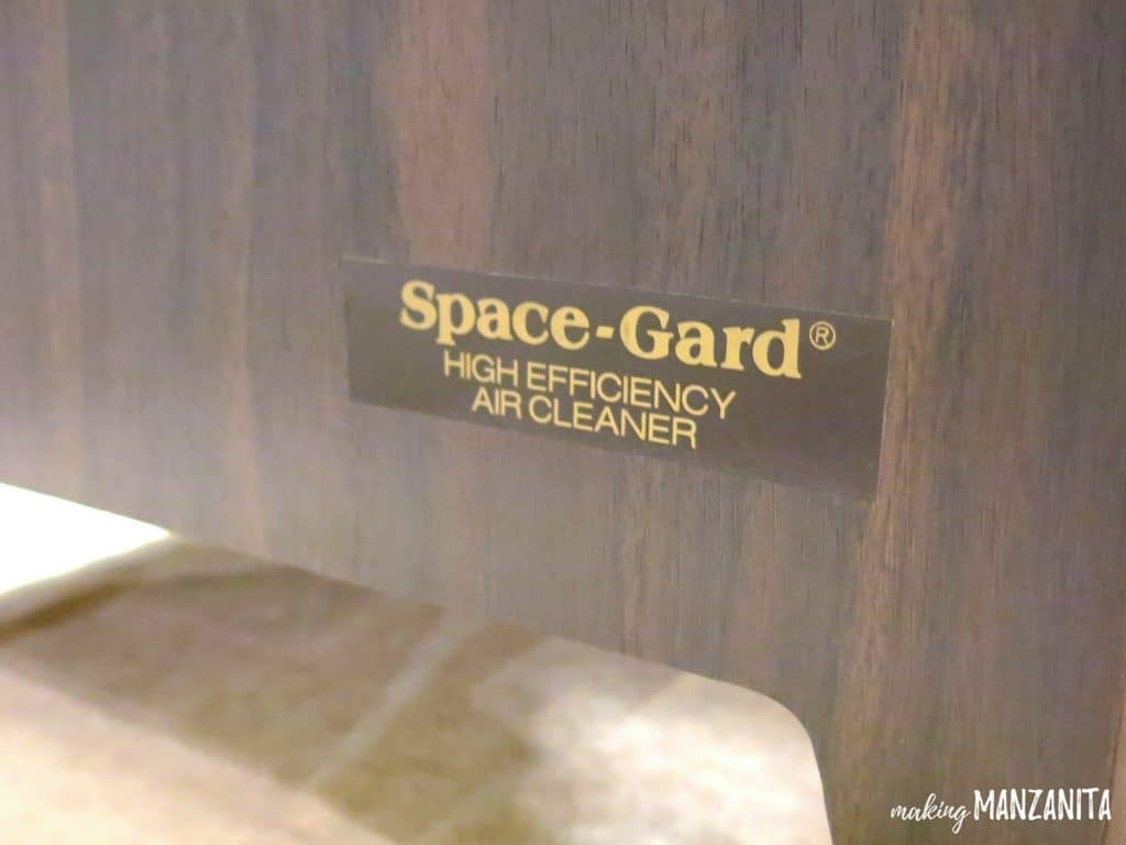 close up shot of a label that reads space-gard high efficiency air cleaner