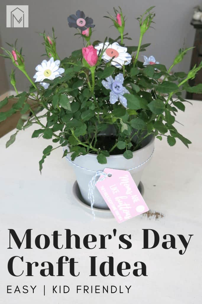 Potted plant with buttons flowers sticking in it on a white table with printable tag that says moms are like buttons they hold everything together tied onto potted plant with text overlay that says Mother's Day craft idea Easy and kid friendly