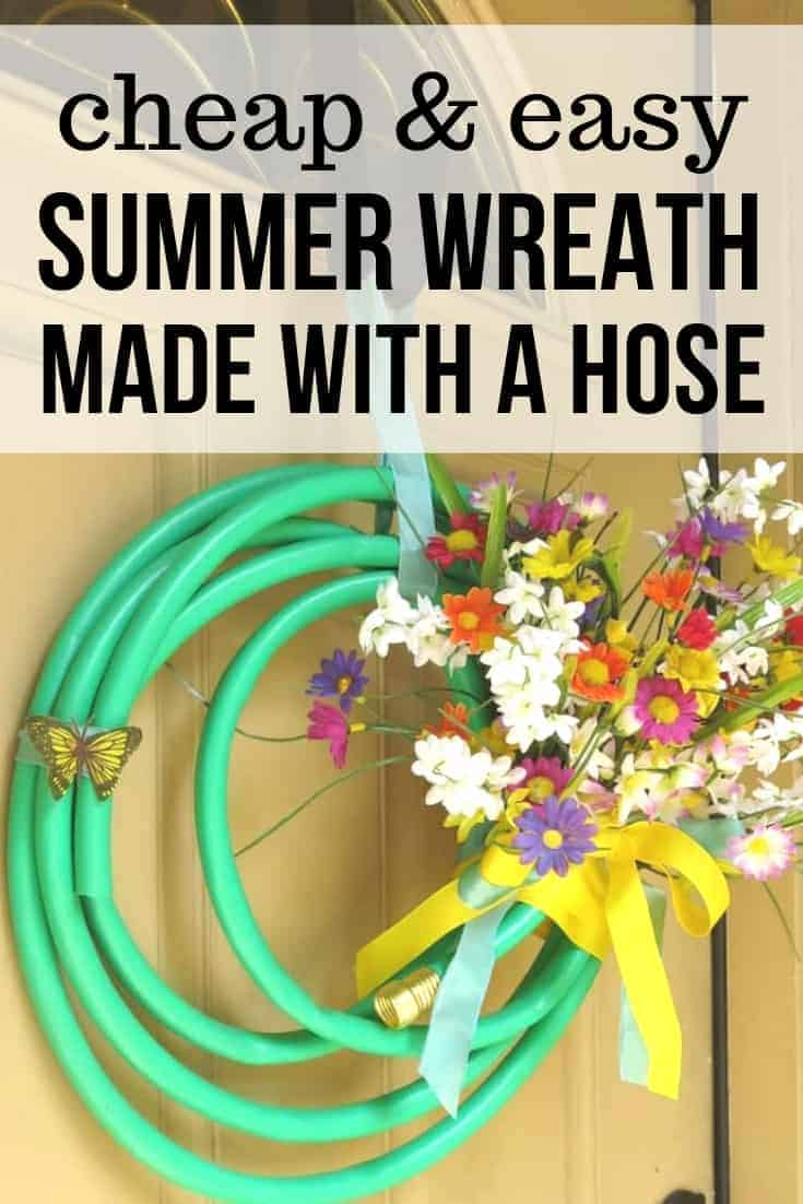 Brightly colored upcycled wreath for summer make with a green garden house and Dollar Store faux florals with text overlay that says cheap and easy summer wreath made with a hose