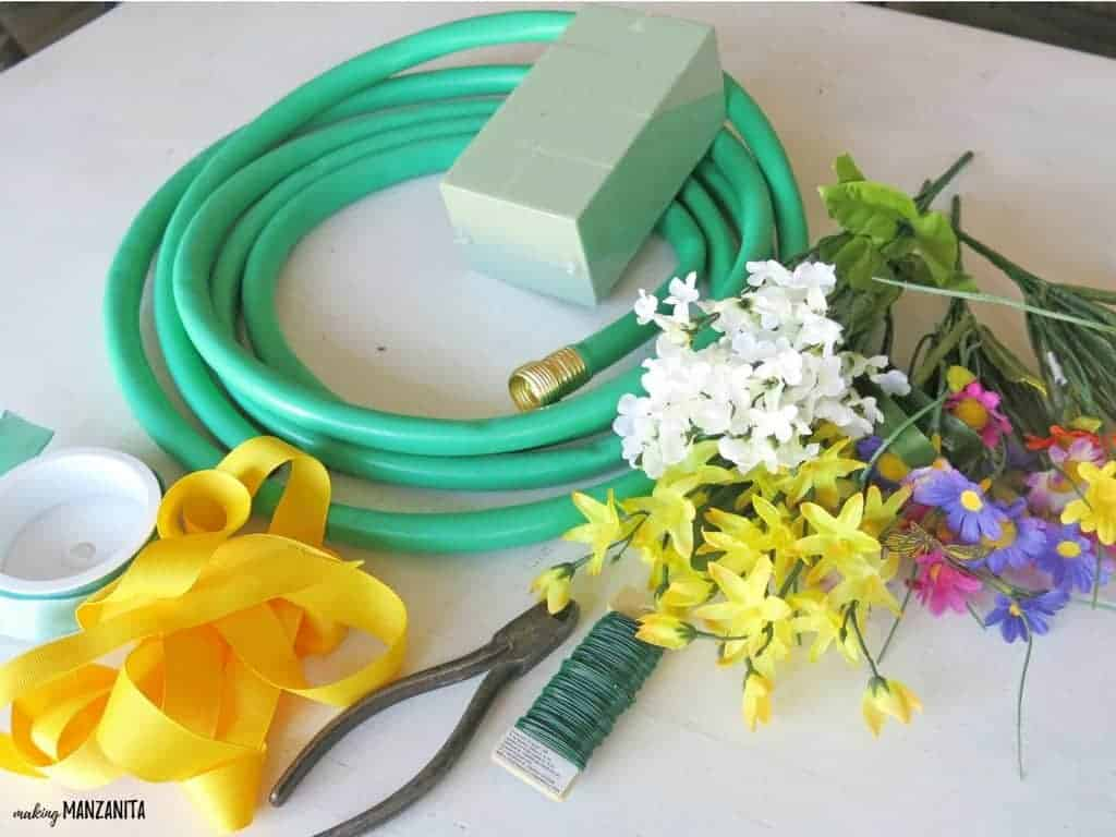 Summer wreath making supplies (garden hose, floral foam block, faux flowers, ribbon, floral wire, wire cutters)