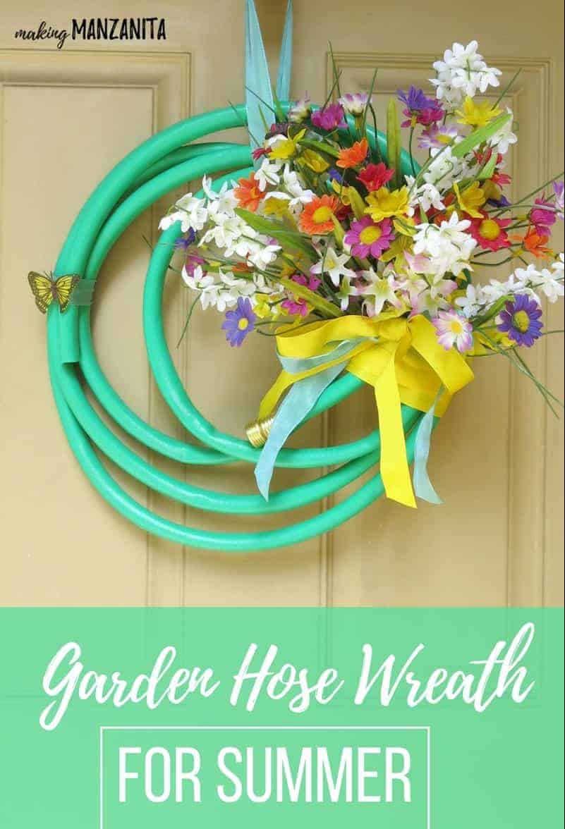 Bright green garden hose upcycled into a summer wreath with flowers and text overlay that says garden hose wreath for summer