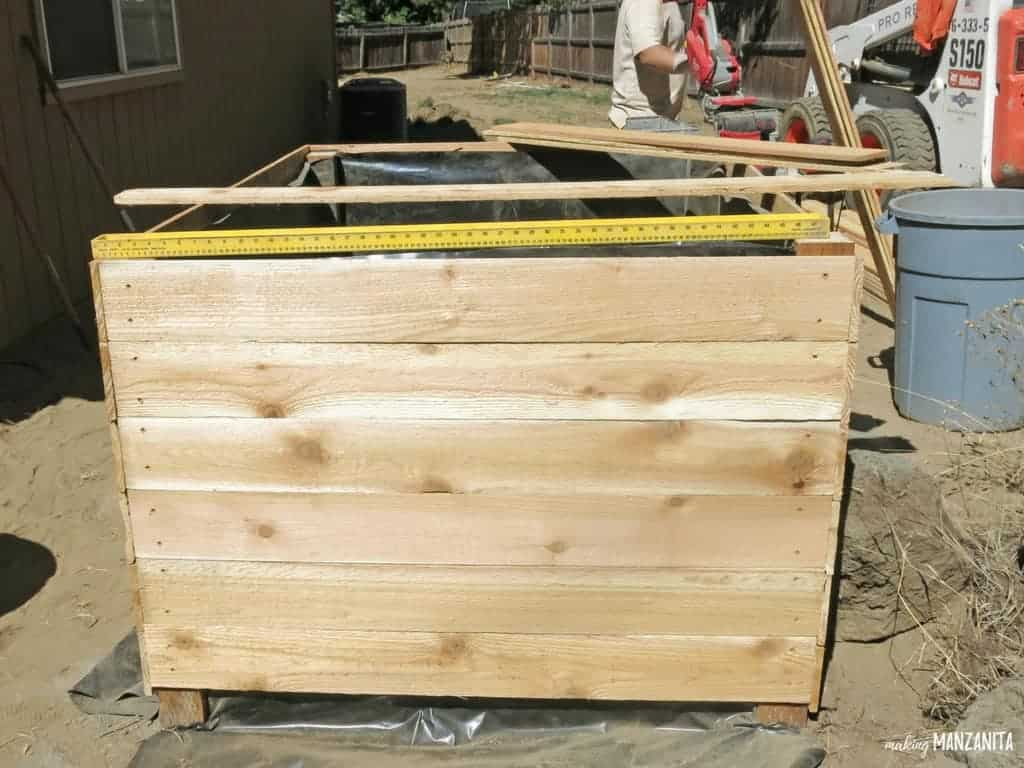 DIY Raised Garden Beds Using Cedar Bards | How to build raised garden beds | How to build DIY raised garden beds using fence boards | Cedar fence boards turned into garden beds | Tall Raised Garden Beds | Learn how to make your own raised garden beds so you can garden right in your backyard | Raised garden beds vs in-ground garden beds | What type of material to use in raised garden beds | Tall garden beds so you don't have to bend over | Building raised garden beds | Backyard gardening | Weekend project | DIY Garden Beds