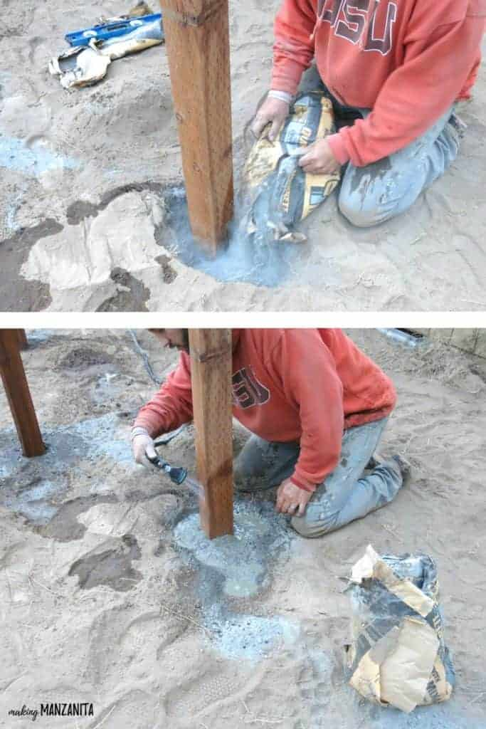 Top grid of man pouring concrete at the bottom of the standing wood post and bottom grid of man running water from a hose over the concrete and wood post on the corners of the wood garden beds during building process