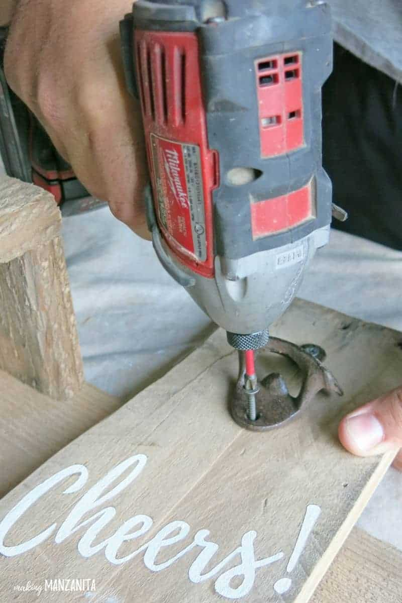 Drilling bottle opener to wood piece that is painted with Cheers
