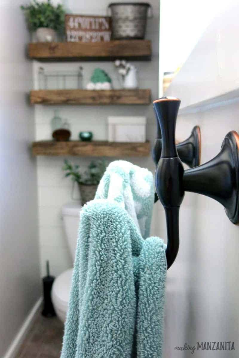 Oil Rubbed Bronze Towel Hooks instead of Towel Bar | Space Saving Tips for Small Bathroom | Use towel hooks instead of a bar | Farmhouse Master Bathroom Reveal | Budget-Friendly Farmhouse Bathroom | Farmhouse Style Bathroom | Fixer Upper Style Bathroom | Master Bathroom with Farmhouse Style | Mint Green & White Bathroom | Mint and White Bathroom | Small Bathroom Design | Farmhouse Bathroom on a Budget | Farmhouse Design Bathroom | En-Suite Farmhouse Bathroom | How to design a farmhouse bathroom | How to decorate with farmhouse style in a bathroom