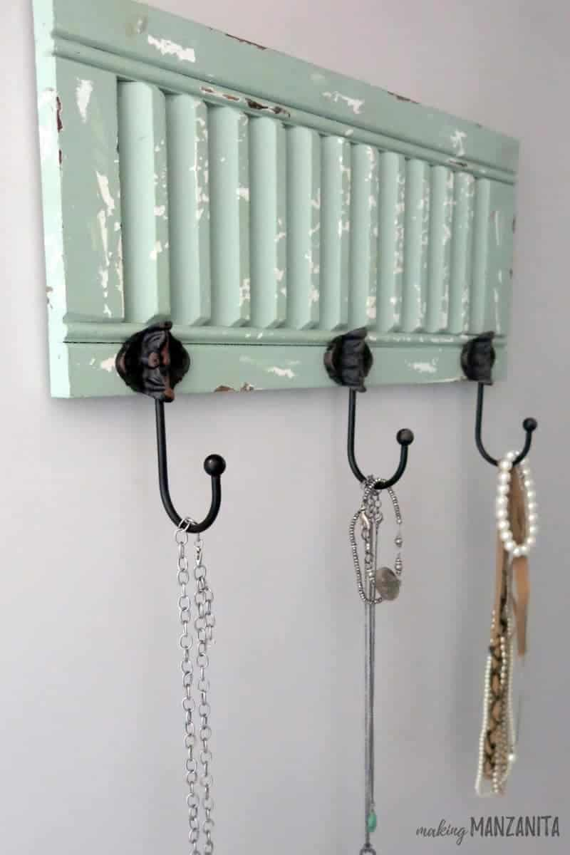 Chippy Paint Shutter with Hooks on wall with hanging necklaces