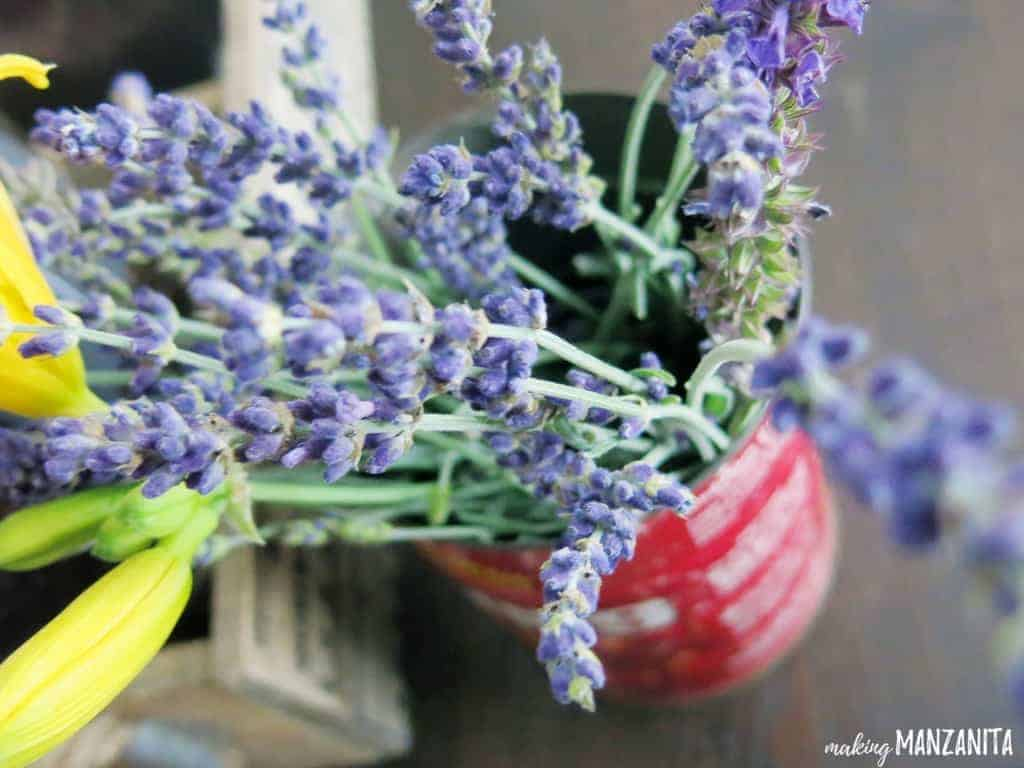 Fresh lavender and flowers in a vintage tin | Vintage coffee container with fresh flowers | Summer decorating tips