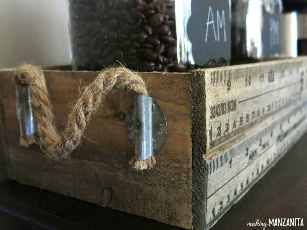 Vintage inspired crate with rulers and rope
