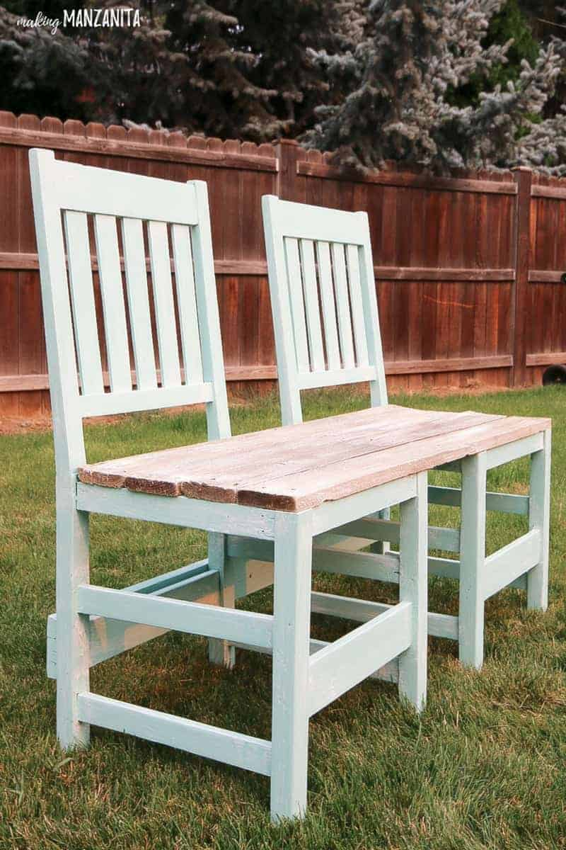 Upcycled Chair Bench for your backyard | Upcycle 2 old chairs into a bench | Repurposed chairs turned into an outdoor bench | DIY outdoor bench with thrift store bench | Painting outdoor furniture | DIY Outdoor furniture with thrift store chairs and an old pallet | 2 chairs turned into bench | Bench made from chairs | Painting wood chairs | How to create bench from chairs | Recycled chairs | Upcycle furniture projects | Backyard DIYs | DIY seating for your backyard | DIY for Summer